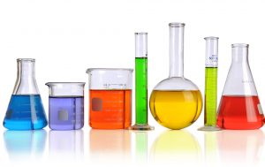 Laboratory glassware with liquids of different colors isolated over white background